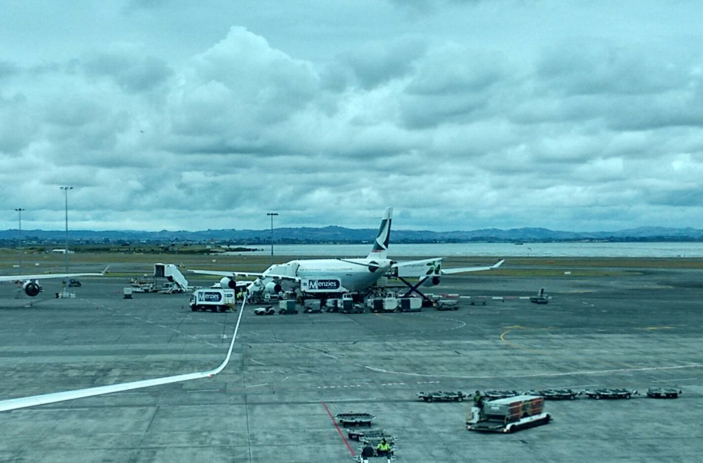 CX 197/198 plane sits on tarmac at Auckland International Airport